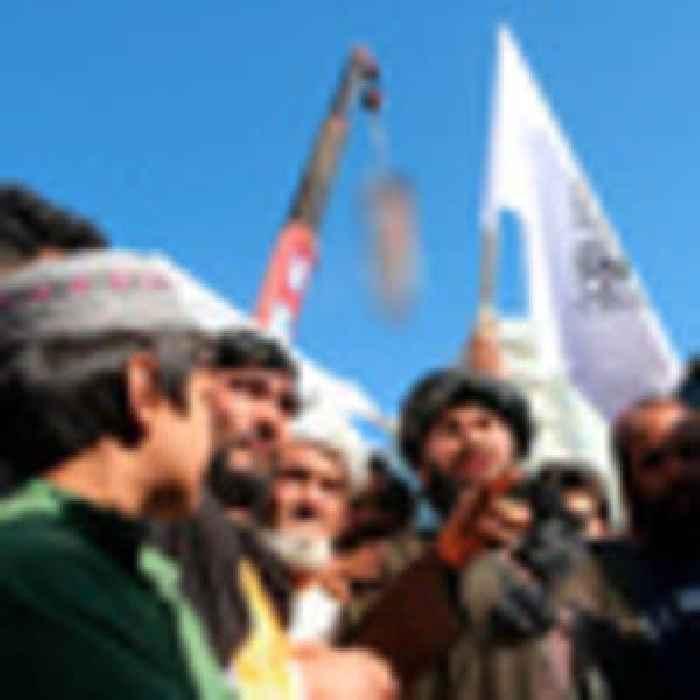 Taliban hang body in public, signalling a return to past tactics