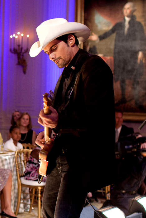 First lady touts vaccine with singer Brad Paisley