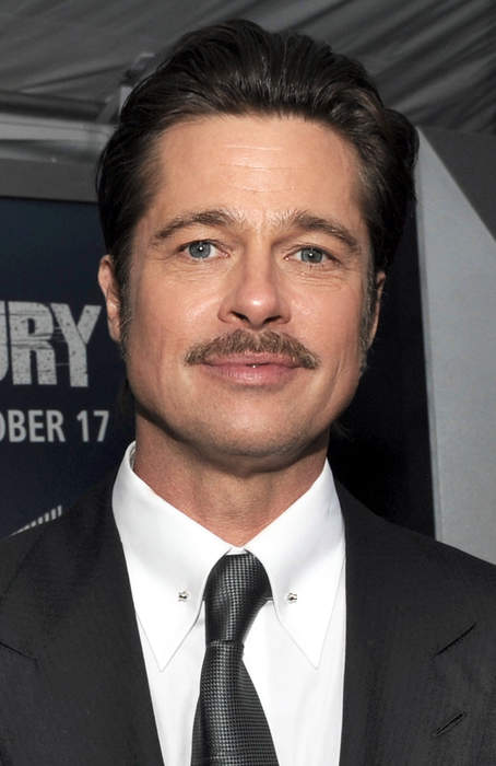 Brad Pitt's Tatted Up and Snorkeling for Island Vacay