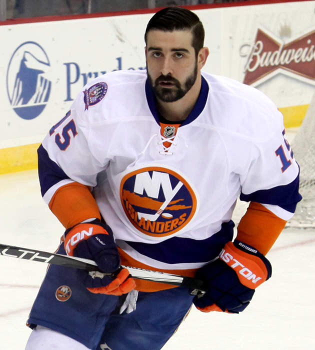 New York Islanders' Cal Clutterbuck slashed on wrist by skate after he checks Boston Bruins' Patrice Bergeron