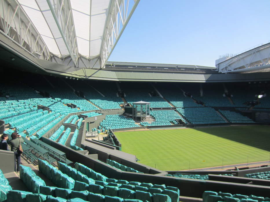 What is making Wimbledon Centre Court so slippery?