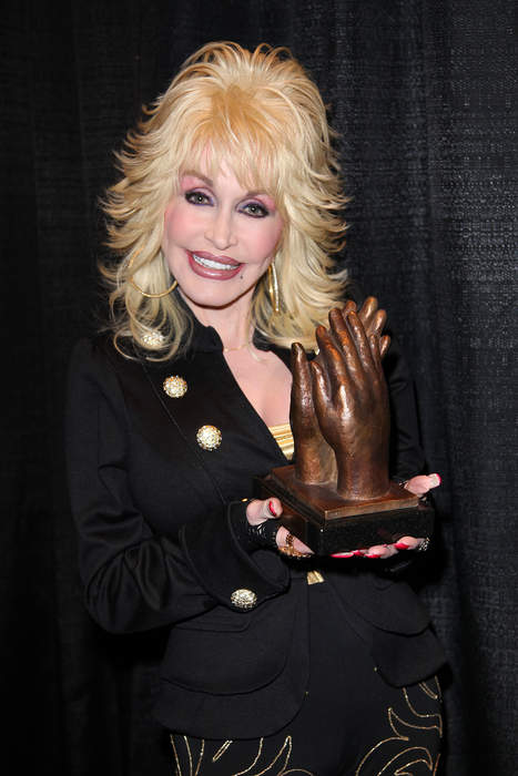 Dolly Parton Gets First Dose of Moderna COVID Vaccine, Busts out New Song