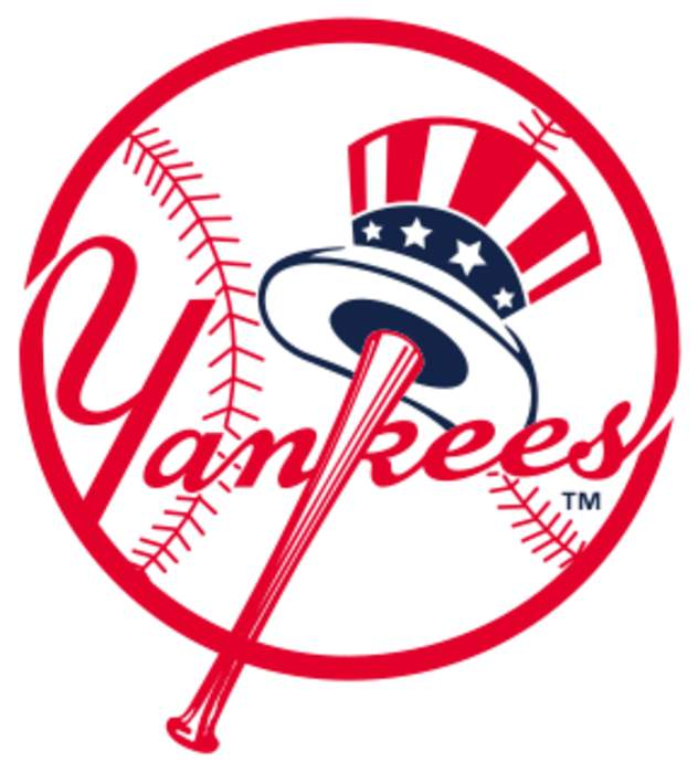Yankees, Nationals players all kneel before national anthem in MLB opener