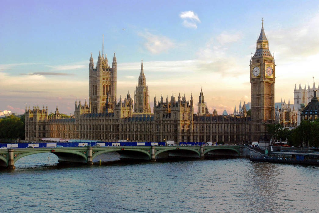 UK lawmakers 'conga' round parliament to cast their votes