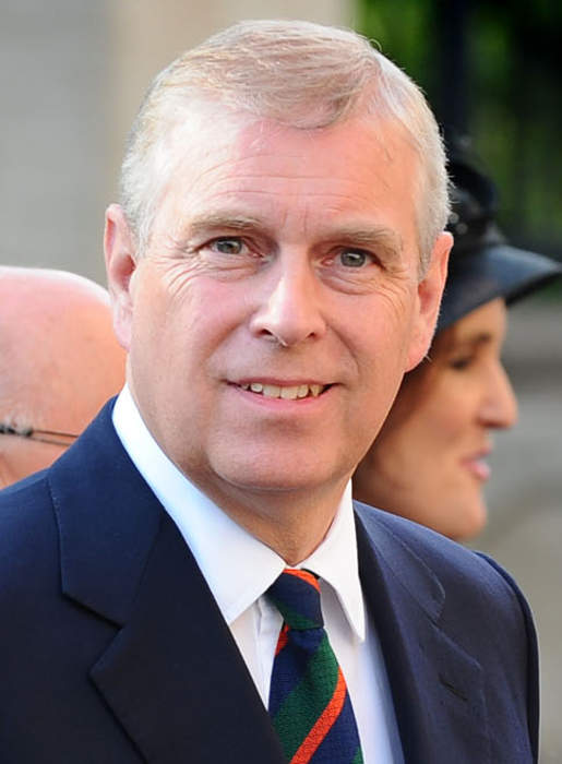 Tell Prince Andrew to call FBI says message on U.S-style bus near palace