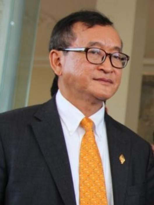 Cambodia opposition founder says he was blocked from boarding plane home from Paris