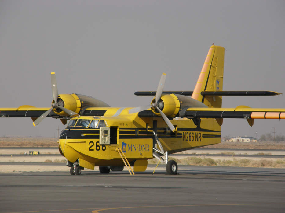 Firefighting plane drops water on Telegraph Fire as blaze grows to more than 85,000 acres