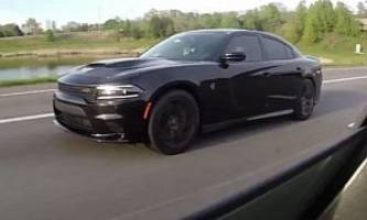 dodge charger hellcat can't keep up with a bmw e39 m5  - video