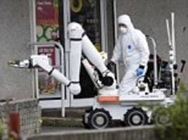 Homes evacuated as bomb disposal robot is called in to detonate suspect package 'wrapped in foil with wires and battery' outside Co-op supermarket