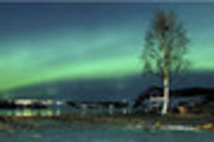 travel: exploring the northern lights through coastal waters