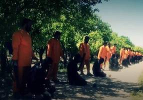 In cold revenge, Syrian rebels execute Islamic State fighters in orange jumpsuit