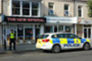 Police continue to guard scene of double stabbing
