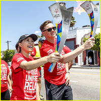 jessica sanchez & jesse mccartney carry the torches for special olympics unified relay across america