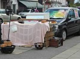 Homeless man sets up shanty town shack made out of a crate, planks, bricks and a sheet in London