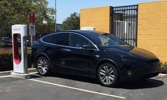 tesla model x crossover spotted at supercharger site, has cool panoramic windshield