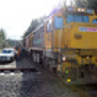 train hits ute in near miss accident
