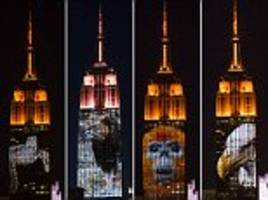 Empire State Building used to show 350-foot tall picture of Cecil the Lion and endangered animals as New Yorkers gather in streets for stunning display