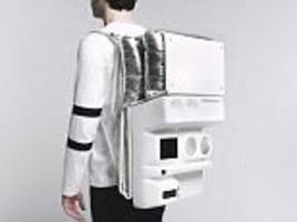 The future of picnicking has arrived: The space age backpack that contains a table, cup holders and USB hubs