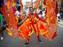 UK weather forecasts rain but Notting Hill Carnival revellers ignore warnings