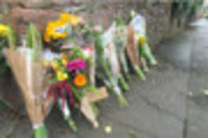 Flowers left and tributes paid to victim of suspected hit and run...