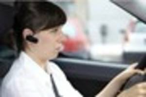 call to ban motorists from using hands-free kits while driving is...