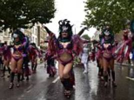 Carnival revellers refuse to let the rain put a dampener on festivities thousands pack the streets of Notting Hill