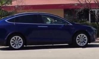 two model x crossovers spotted at a supercharger, they look ready to meet buyers - video