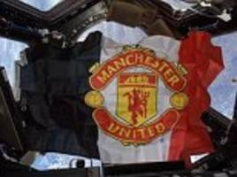 russian manchester united fan put flag in space to see his team on top