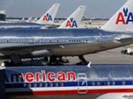 BREAKING NEWS: American Airlines captain dies at the controls despite desperate efforts of air stewardess to save him