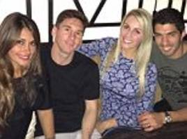 Barcelona stars Lionel Messi and Luis Suarez enjoy night on the town with their partners after Champions League heroics