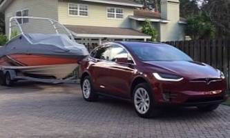 watching a tesla model x towing a boat is oddly satisfying - video