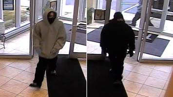 Two men wanted for Lawrence bank robbery
