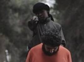 English-speaking child issues chilling warning to America before beheading prisoner in latest sick ISIS video