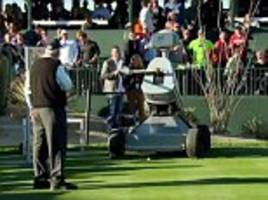 robot named after tiger woods makes hole-in-one at phoenix open as fans shower the green in beer cups