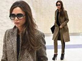victoria beckham wears matching jacket and trousers in new york city