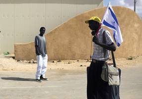 knesset lowers maximum migrant detention in holot to 12 months