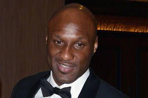 Lamar Odom Attends Kanye West's Fashion Show After Life-Threatening Brothel Incident