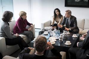 George Clooney and Wife Amal Discuss Refugee Crisis With Angela Merkel in Berlin