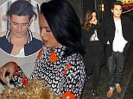 That's awkward! Katy Perry narrowly avoids ex-boyfriend John Mayer and his stunning mystery woman as she hits Adele concert with new beau Orlando Bloom