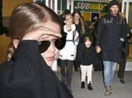 Harper Beckham arrives in NYC with David to support mum Victoria at Fashion Week