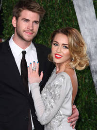 miley cyrus and liam hemsworth get 'married' in secret ceremony - 1 month after engagement reports