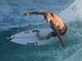 'empty' fanning to surf at shark attack site