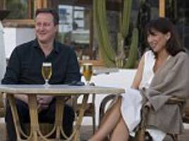 david cameron and wife samantha 'enjoy' a stage-managed start to their holiday