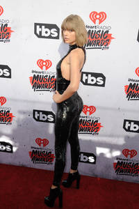 taylor swift slays at the iheartradio awards in a hot black catsuit - see pics!