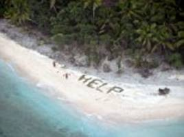pictured: the call for 'help' written in palm fronds that saved the lives of three men trapped on an uninhabited island for three days in the pacific after their boat became overwhelmed by large waves