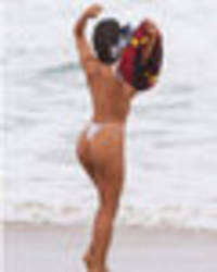 football strip: miss bumbum sheds jersey to go topless after messi snub