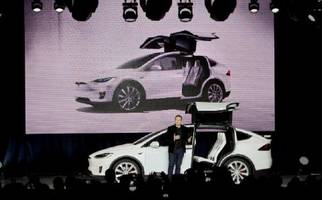 tesla model x owners report problems with doors, brakes and more