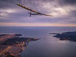 touchdown! stunning shots show solar impulse 2 elegantly soaring above the golden gate bridge and landing in san francisco during the latest leg of its round-the world trip
