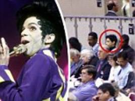 pictured, prince at a jehovah's witness conference - with the guitar star who brought him to the faith sitting by his side