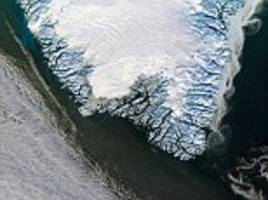 Is Greenland making Europe wetter? Climate change on icy island may be blocking weather systems, making summers worse further south